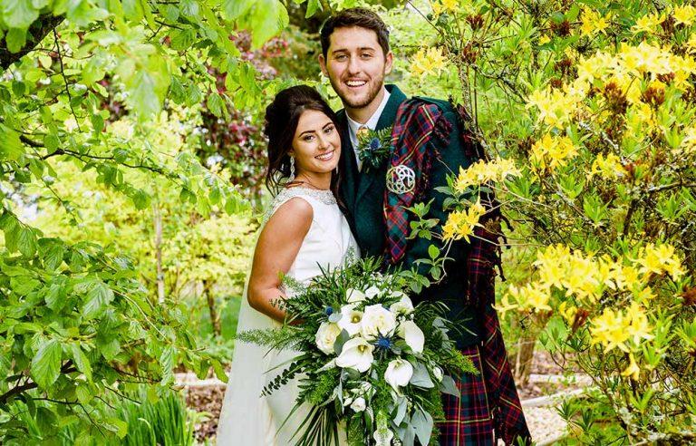 wedding photographer photo of couple with yellow flowers