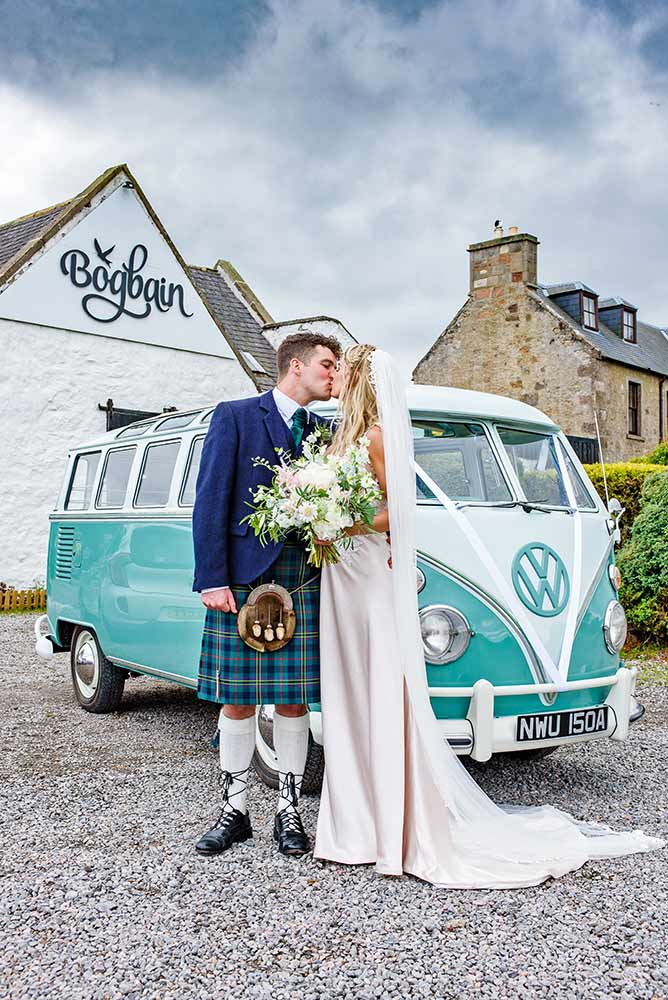 wedding couple kiss by volkswagen camper