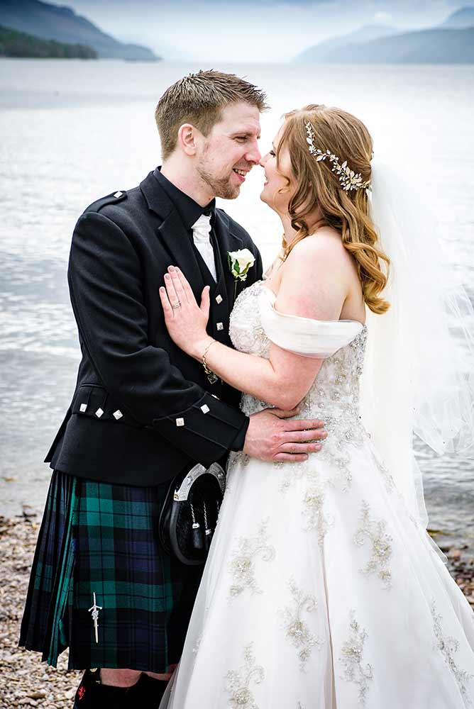 wedding photographer image of couple embracing by loch ness