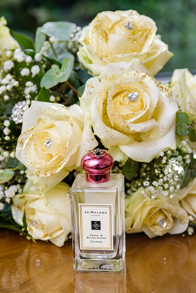 brides perfume, flowers and wedding ring