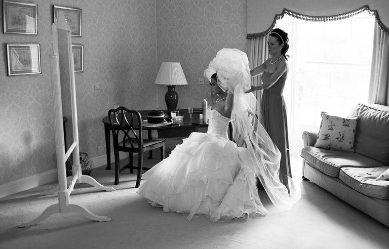 bridal preparation photo, adjusting the veil