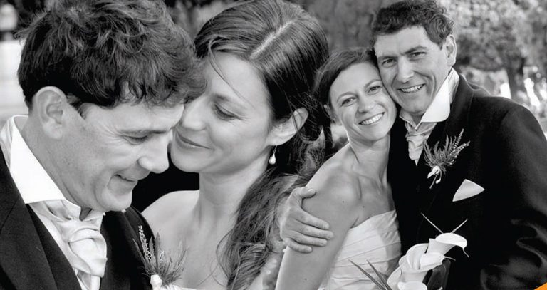 black and white wedding photo composite of couple embracing