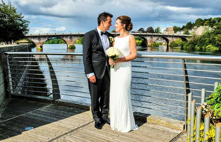 bride and groom by river tay, perthshire