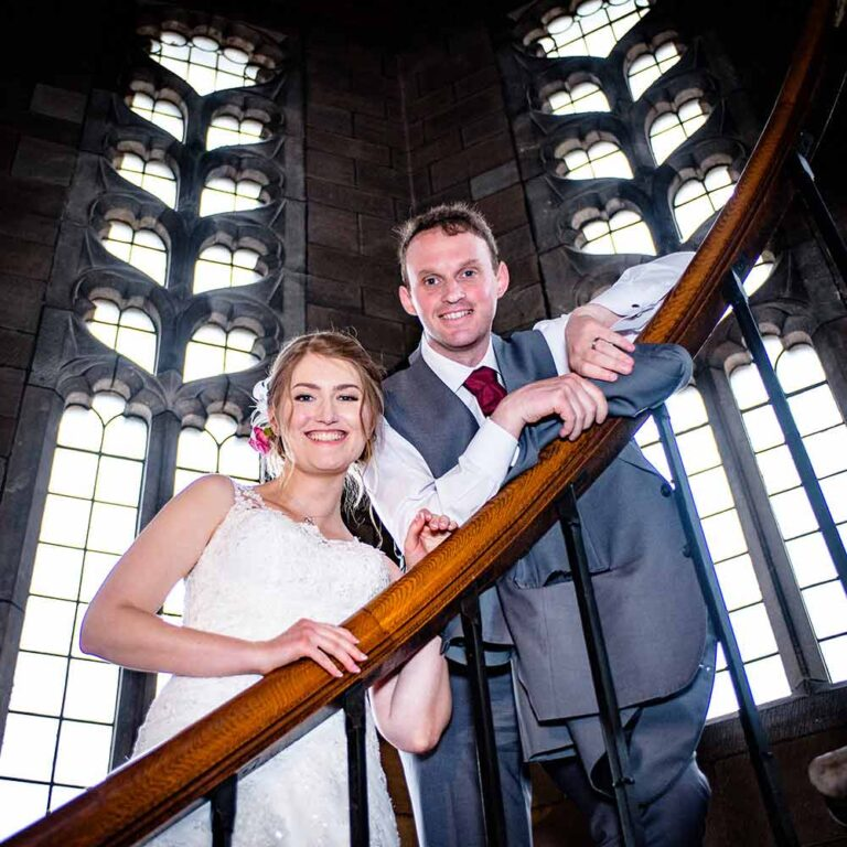 bride and groom with gothic window background