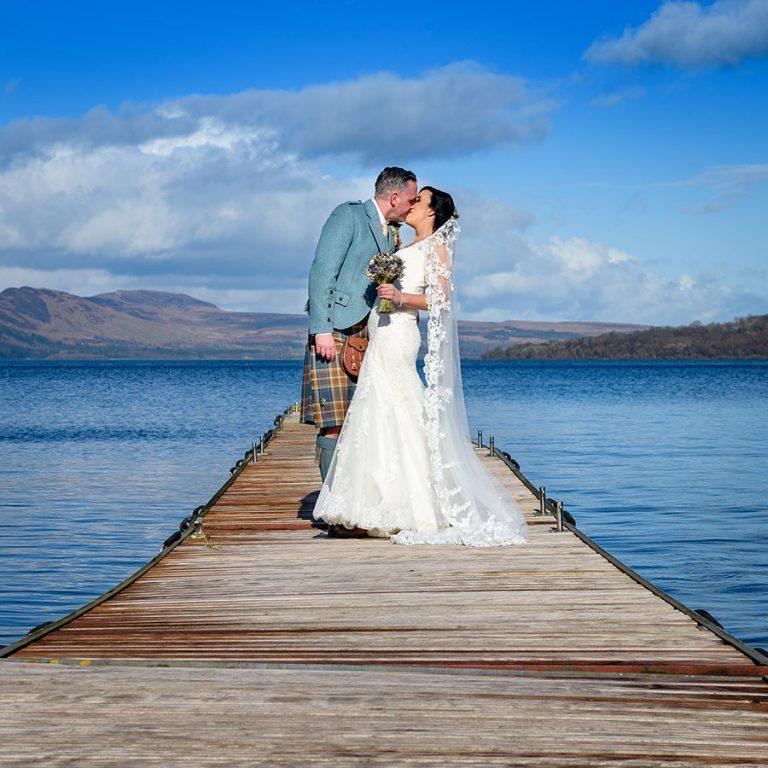 wedding photo in Scotland, Loch Lomond, couple on pier