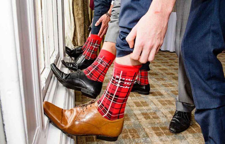 male wedding guests with tartan socks