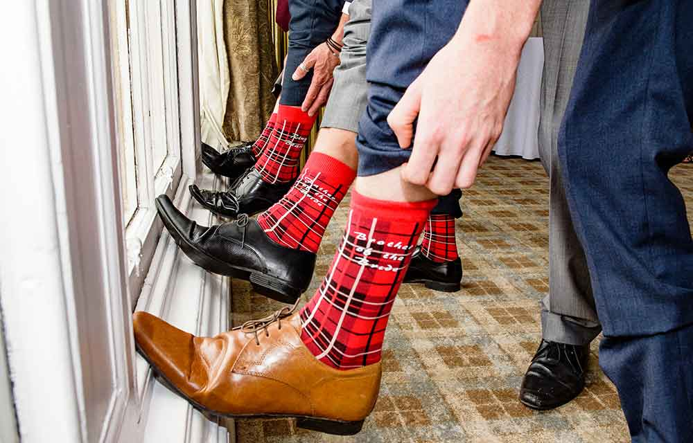 male wedding guests with tartan socks