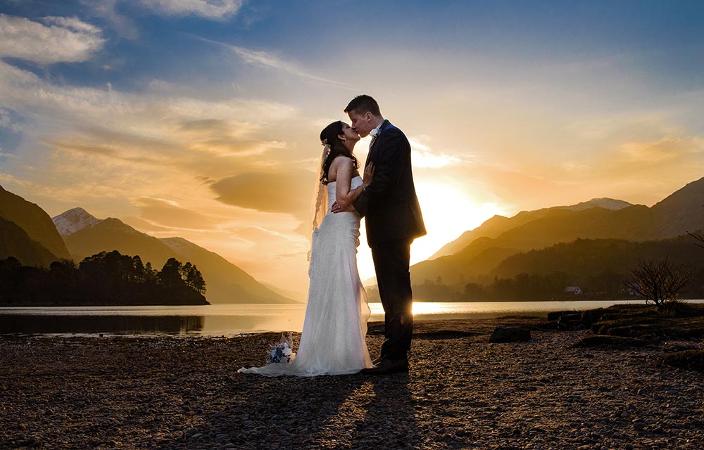 sunset wedding photo of bride and groom, glenfinnan, scotland