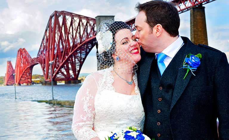bride and groom by forth rail bridge scotland