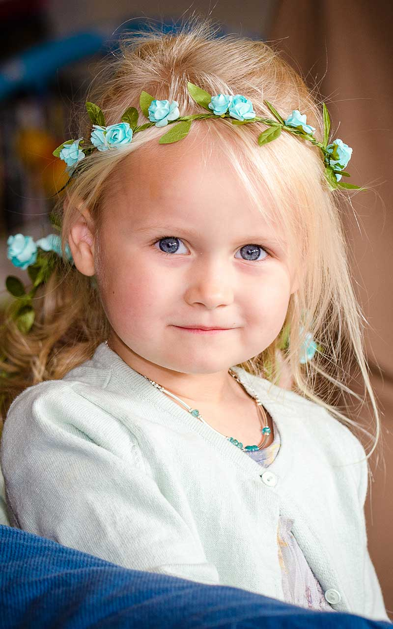 flower girl with blue flowers in her hair