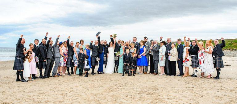 wedding group on beach
