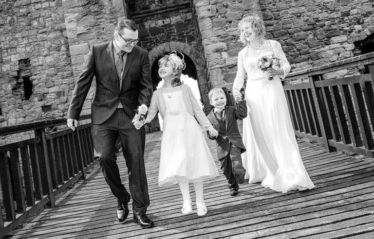 wedding photographer couple and the kids on castle drawbridge