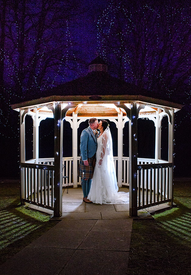 couple in gazebo lit up